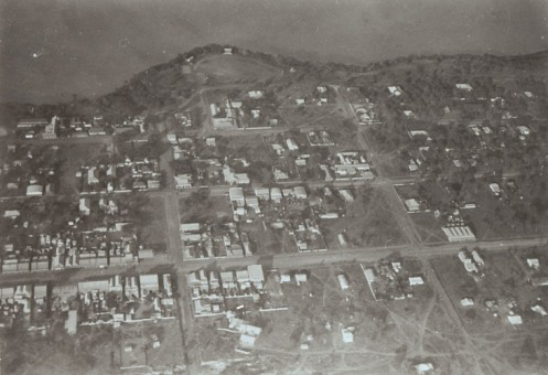 Aerial view of Darwin including Chinatown, looking south (showing Cavenagh St, Smith St,  Mitchell St and the oval on the Esplanade now the cenotaph)