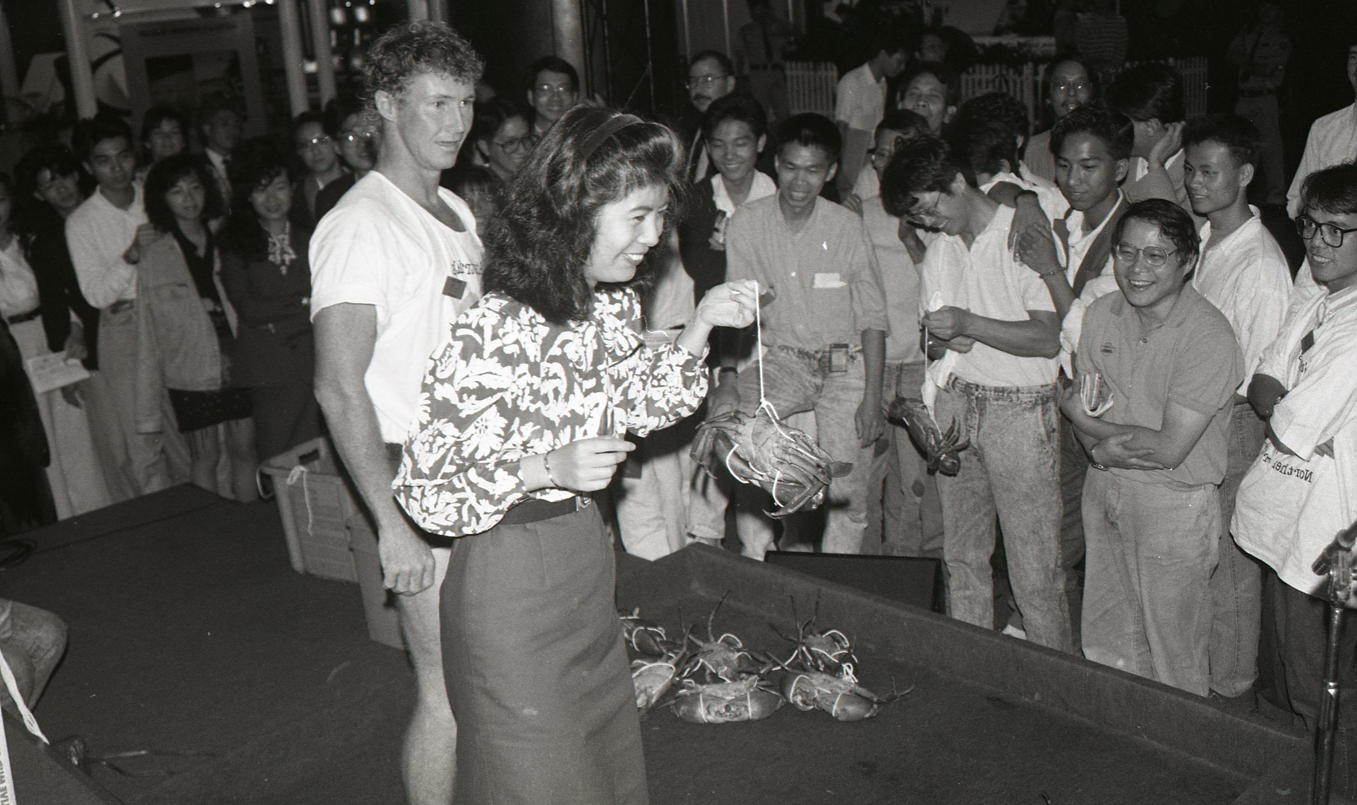 Hong Kong World Expo, Northern Territory delegation Mud Crab Tying demonstration, October 1989<br />Image courtesy of Library & Archives NT,  Department of the Chief Minister, NTRS 3823 P1, Box 11, BW2876, Image 30