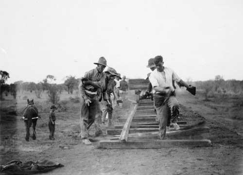 Men laying sleepers and railway line